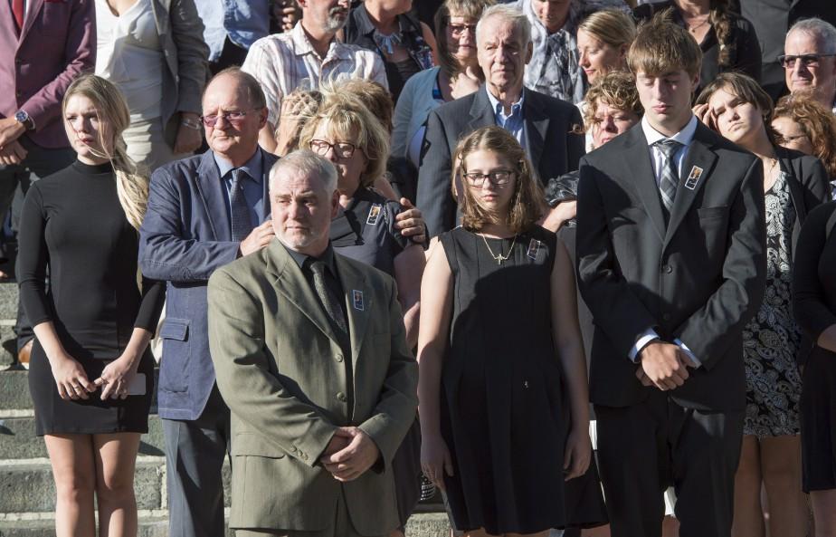 À droite, la fille et le fils de Sylvie Roy, Estelle et Michel. (La Presse Canadienne, Paul Chiasson)