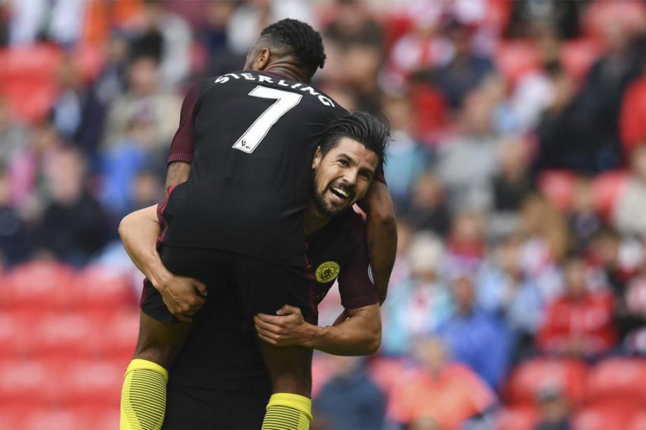 Nolito célèbre l'un de ses deux buts avec... (PHOTO PAUL ELLIS, AFP)