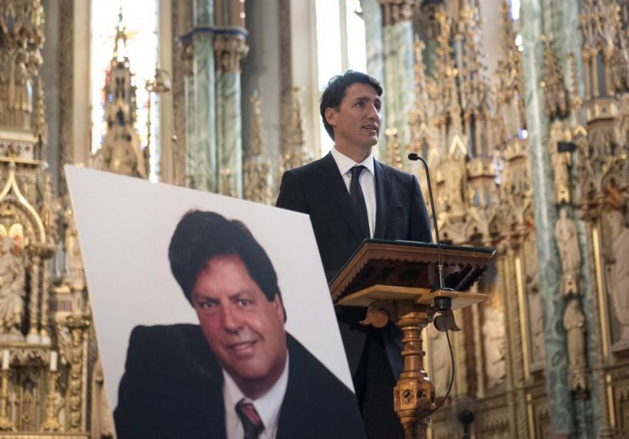 Le premier ministre a pris la parole durant la cérémonie et étalé toute l'admiration qu'il a à l'endroit de son défunt collègue, Mauril Bélanger. (Justin Tang, La Presse Canadienne)