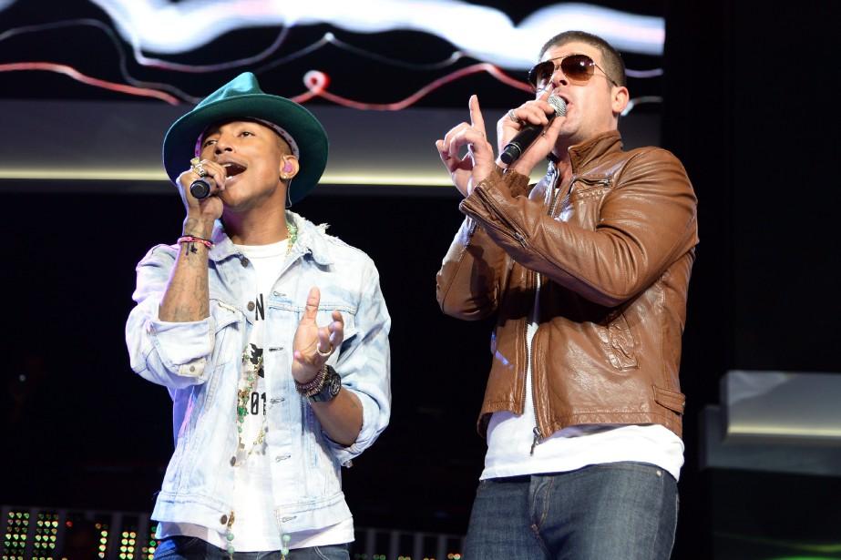 Robin Thicke et Pharrell Williams ont été condamnés... (PHOTO ARCHIVES AFP)