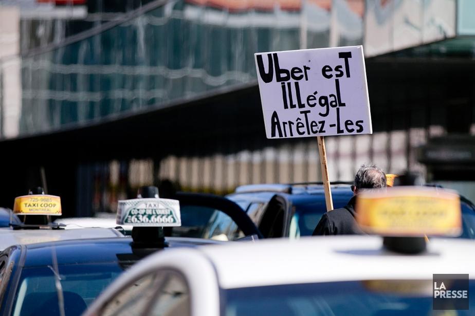 Malgré l'entente entre Québec et Uber, des chauffeurs... (PHOTO DAVID BOILY, ARCHIVES LA PRESSE)