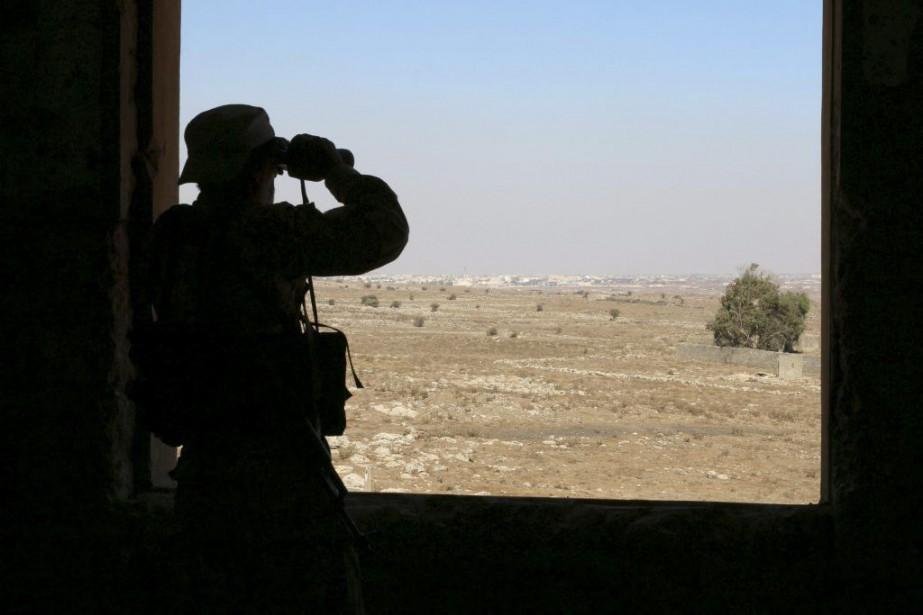 Un combattant rebelle.... (PHOTO ALAA AL-FAQIR, REUTERS)