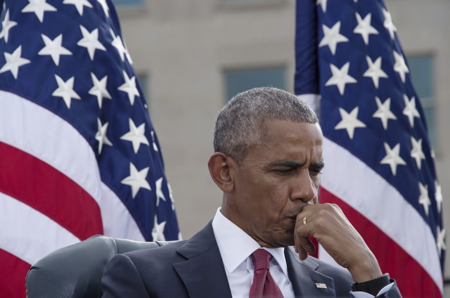 Le président Barack Obama était ému lors d'une cérémonie tenue au Pentagone. (AFP, NICHOLAS KAMM)