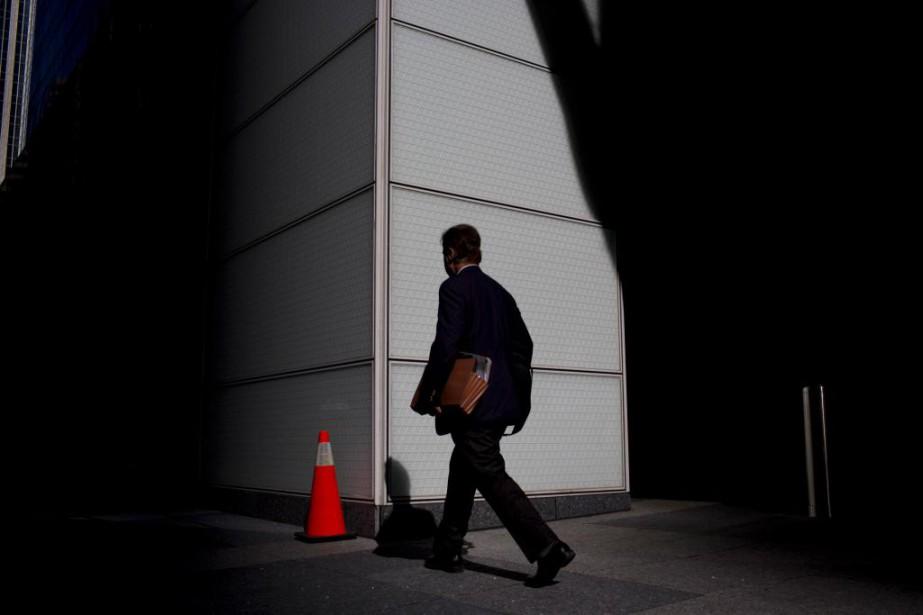A commuter walks on Bay Street in Toronto...
