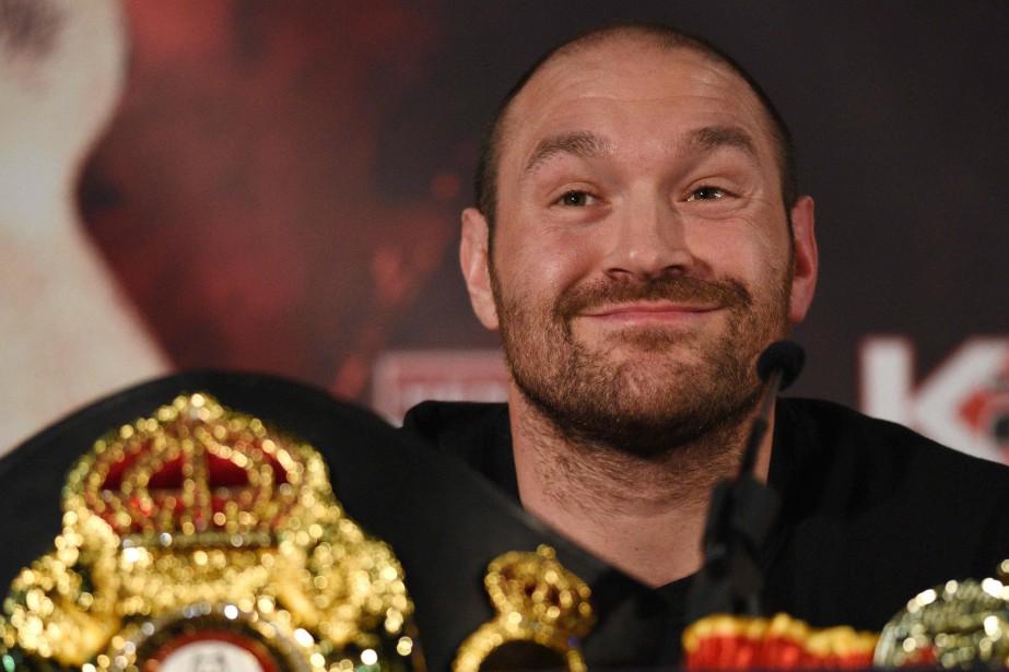 Le champion du monde des poids lourds, le... (Photo Oli Scarfff, archives AFP)