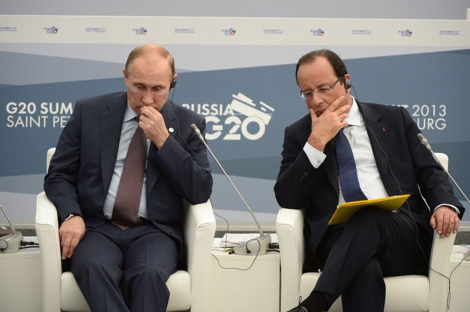 Le président russe Vladimir Poutine (à gauche) et... (photo AFP)