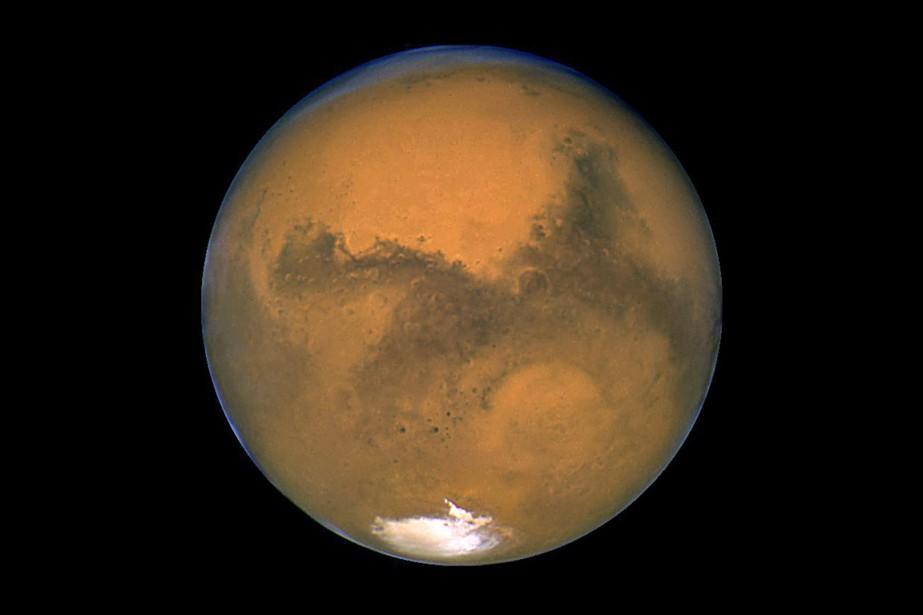 La planète Mars, photographiée en 2003 par le... (PHOTO ARCHIVES NASA VIA AP)