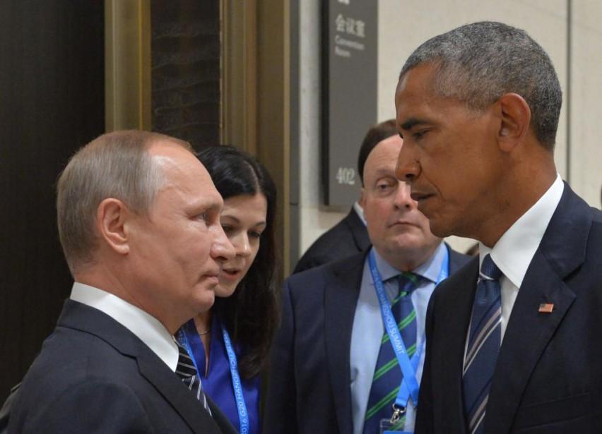 Le président russe Vladimir Poutine et son homologue... (PhotoALEXEI DRUZHININ, archivesSPUTNIK/Agence France-Presse)