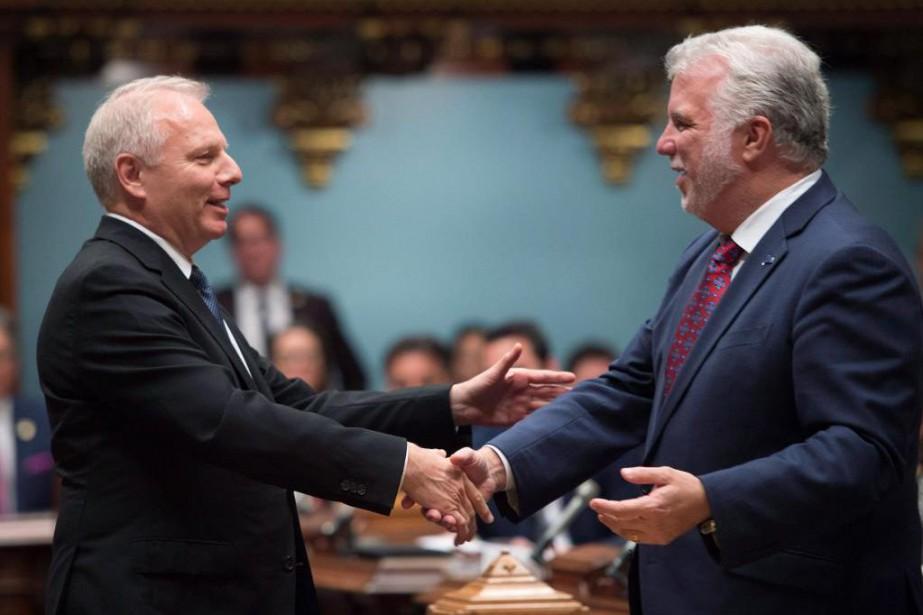 Jean-François Lisée et Philippe Couillard... (PhotoJacques Boissinot, archives La presse canadienne)