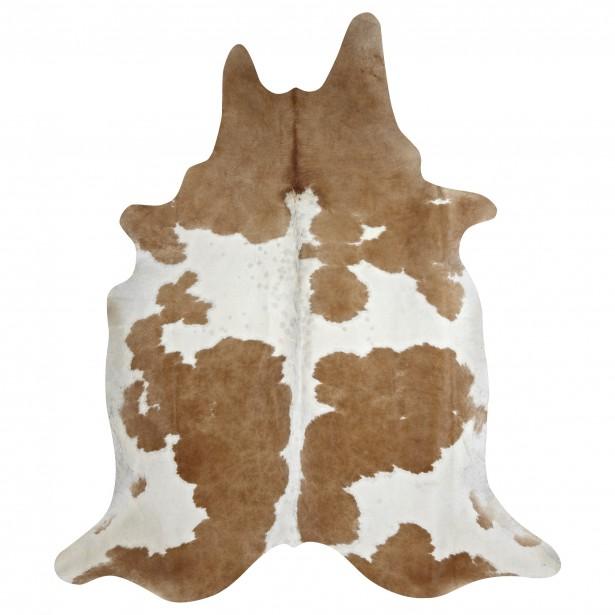 Si on aime l'esprit vieille ferme, un tapis peau de vache sera tout à fait dans le ton. (Photo fournie par Bouclair)