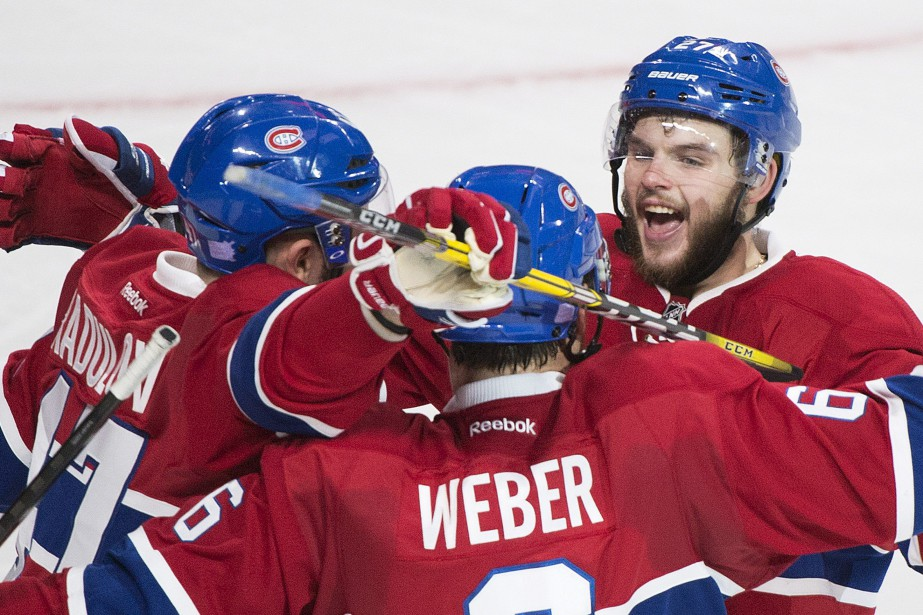 Montreal Canadiens' Shea Weber, centre, celebrates with teammates...