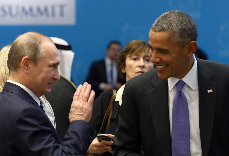 Vladimir Poutine et Barack Obama lors d'une rencontre... (PHOTO KAYHAN OZER, ARCHIVES REUTERS)