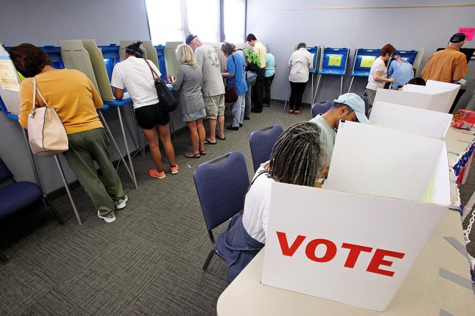 Sur cette photo, des citoyens de la Caroline... (Jonathan Drake, archives REUTERS)