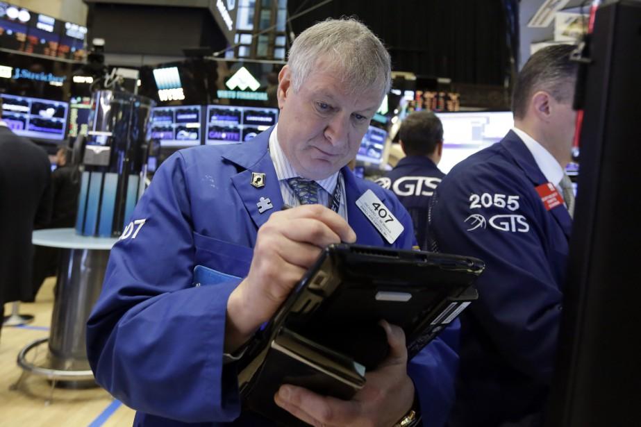 Wall Street a terminé en légère baisse mercredi,... (Photo Richard Drew, AP)