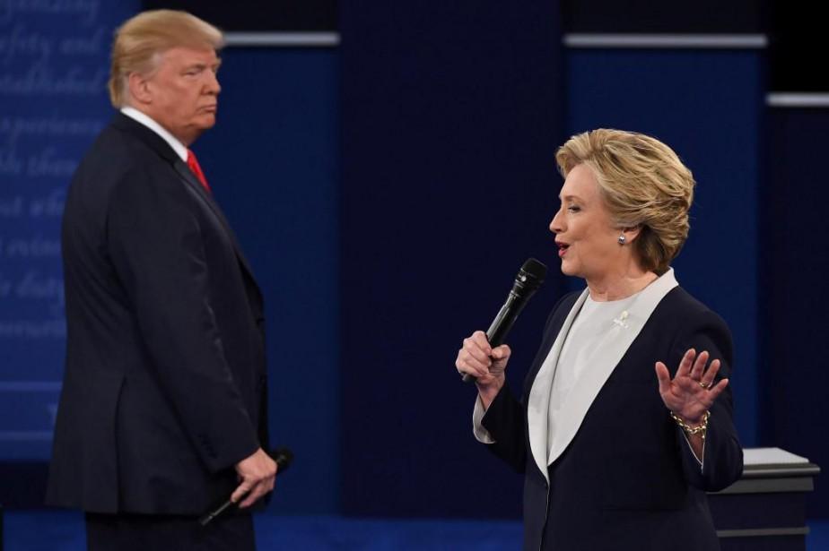 Le candidat républicain Donald Trump et la candidate... (PhotoRobyn Beck, Agence France-Presse)