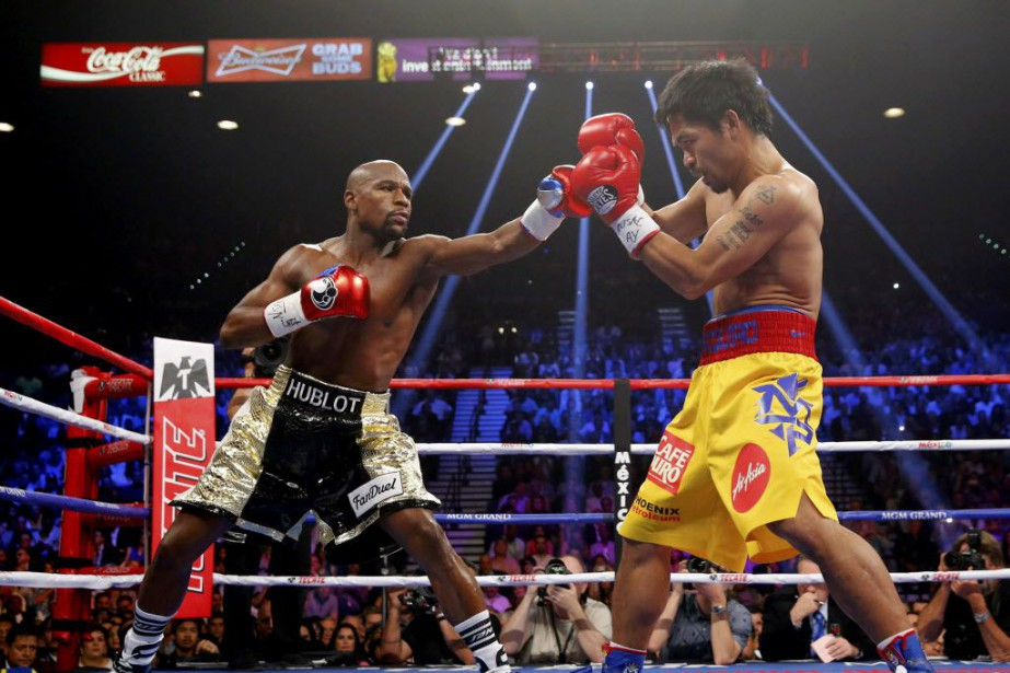 Floyd Mayweather etManny Pacquiao... (Photo Steve Marcus, archives Reuters)