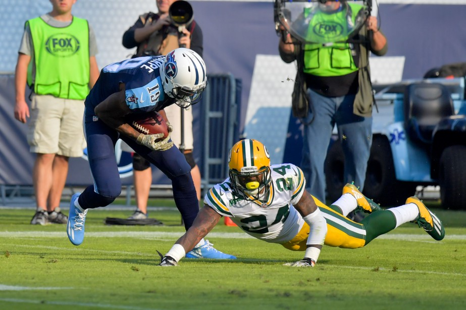 Marcus Mariota a récolté 295 verges de gains en plus... (Photo USA Today Sports)