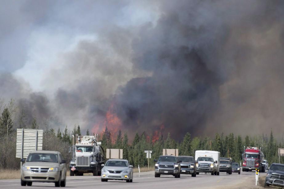 L'activité de reconstruction nécessaire pour rebâtir près de... (PHOTO ARCHIVES LA PRESSE CANADIENNE)