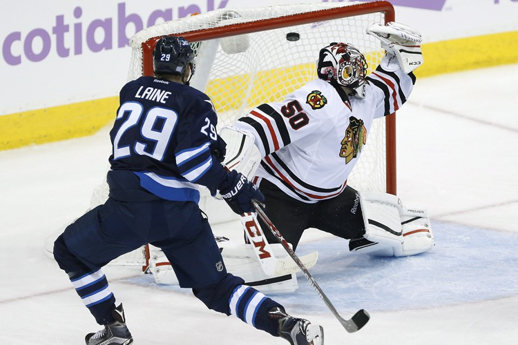 Patrik Laine a signé un 12e filet et Connor Hellebuyck a bloqué 27... (PHOTO PC)