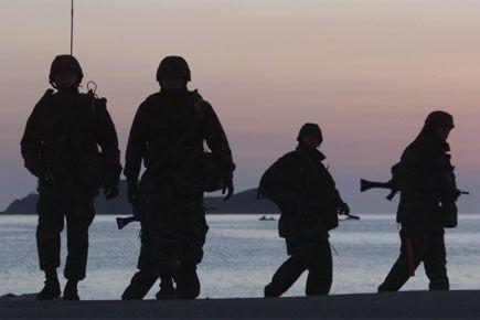 Les menaces de Donald Trump de retirer les troupes... (Photo archives AP)