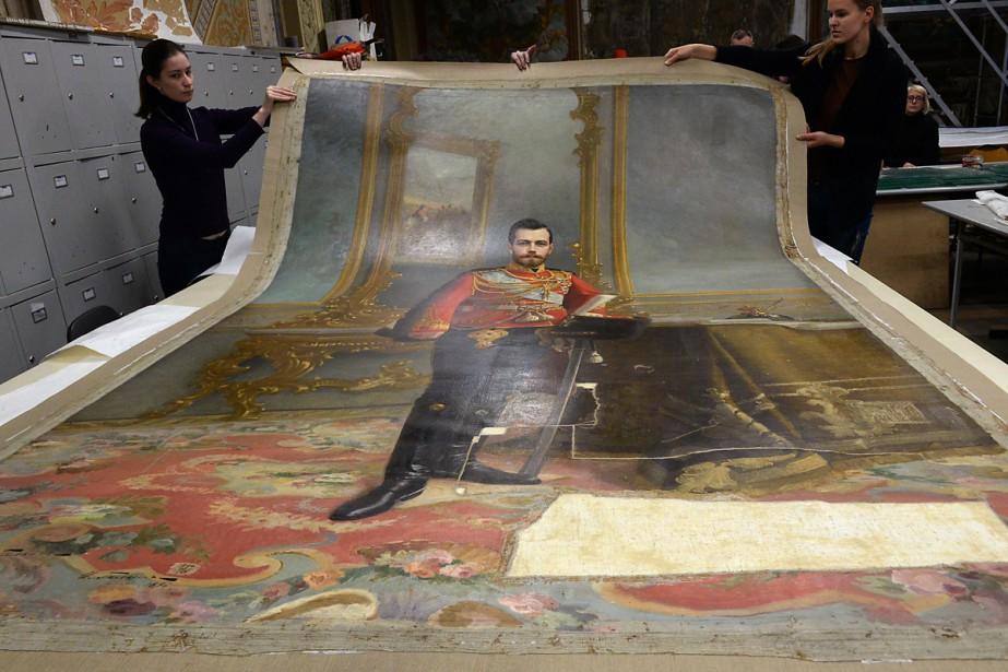 Un portrait du dernier tsar de Russie, Nicolas II, resté caché... (PHOTO AFP)