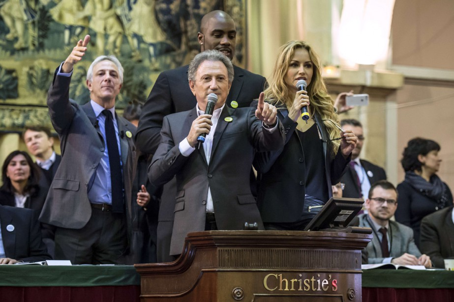En 2014, Teddy Riner, Michel Drucker et Adriana... (PHOTO ARCHIVES AFP)