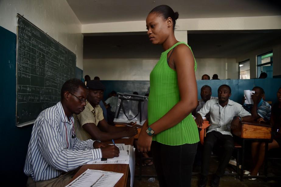 Les Haïtiens sont convoqués aux urnes pour le... (PHOTO HECTOR RETAMAL , AFP)