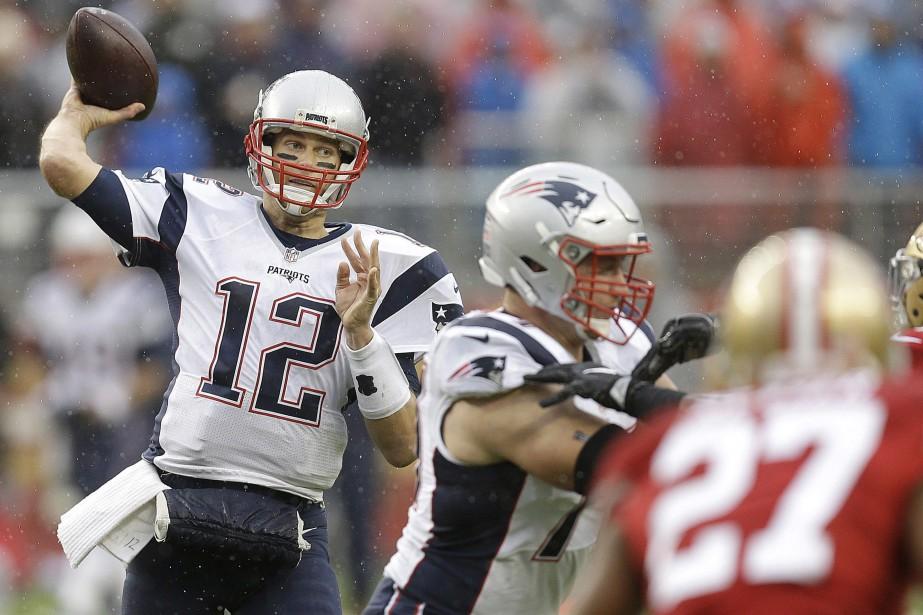 Tom Brady a récolté 280 verges de gains et a lancé quatre passes de... (Photo AP)