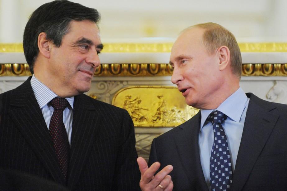 François Fillon connaît bien Vladimir Poutine, qu'il a... (photo NATALIA KOLESNIKOVA, archives AFP)