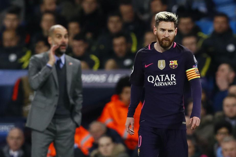 L'entraîneur de Manchester City, Pep Guardiola, et Lionel... (Photo Jason Cairnduff, REUTERS)