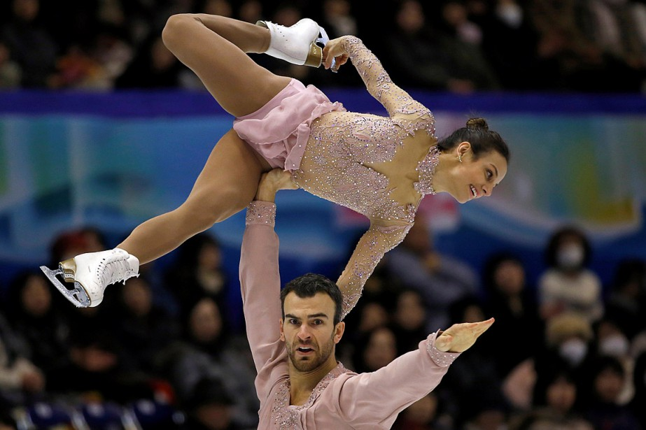 Meagan Duhamel et Eric Radford... (PHOTO ISSEI KATO, REUTERS)