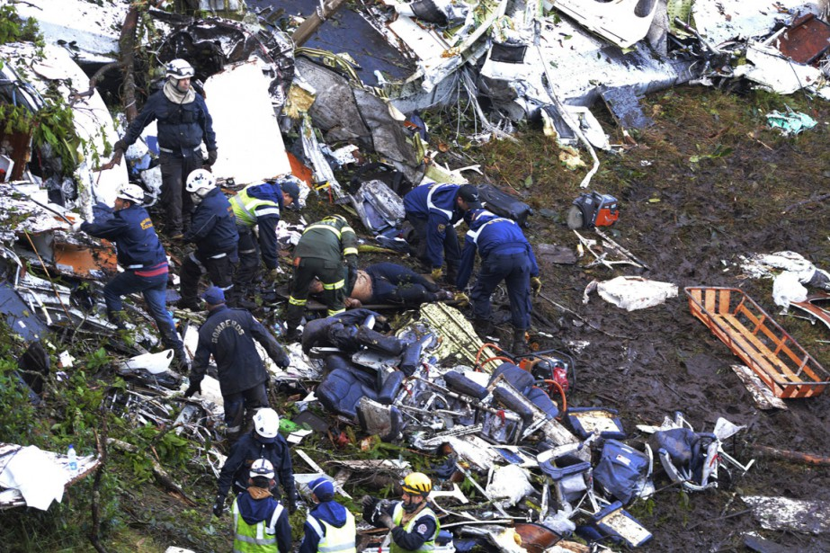 Rescue workers search for survivors at the wreckage...