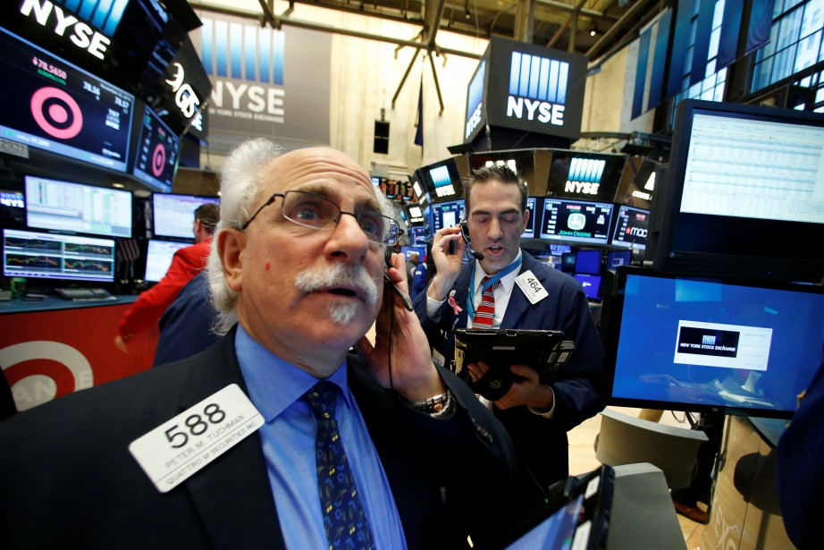 Wall Street a terminé en légère hausse mardi,... (Photo archives REUTERS)