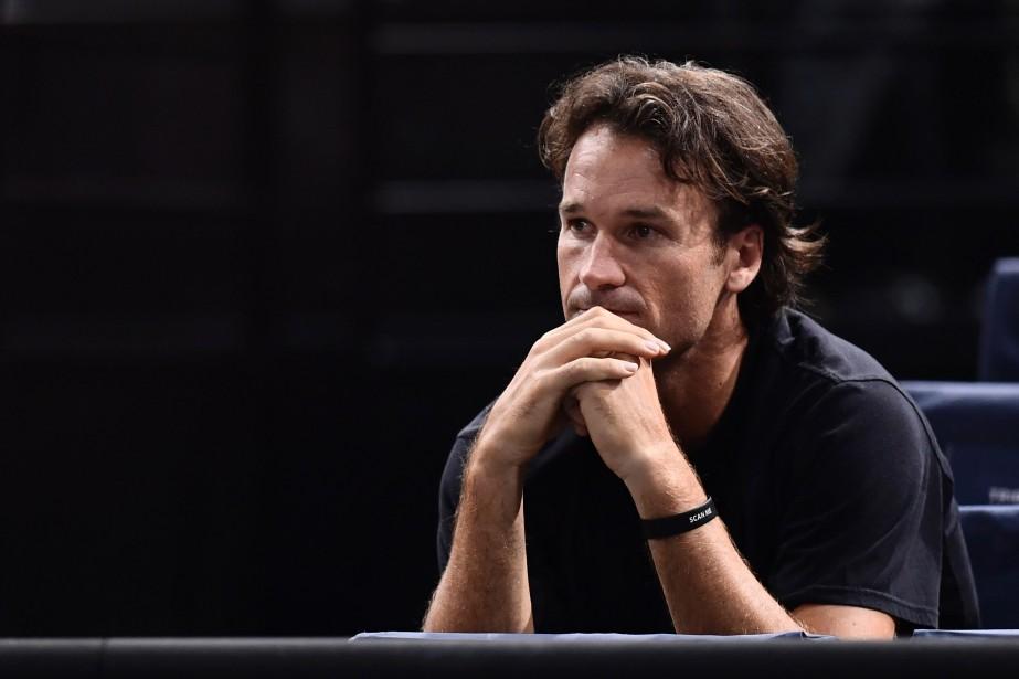 L'entraîneur de Milos Raonic, Carlos Moya.... (Photo Miguel Medina, archives AFP)