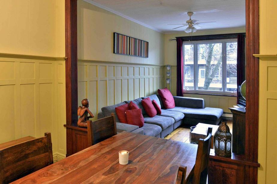 La salle à manger et le salon sont séparés par une arche de bois. (Le Soleil, Patrice Laroche)