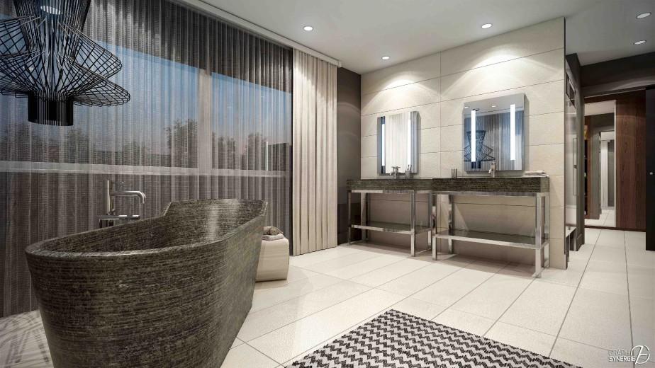 Le meuble-lavabo et la baignoire arborent un fini de pierre naturelle. (Fournie par Graph Synergie)