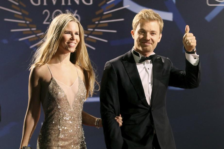 Nico Rosberg, 2016 F1 World champion, right, ...