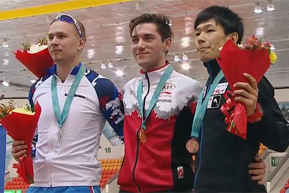 Vincent de Haître adevancé le champion du monde... (PHOTO FOURNIE PAR PATINAGE CANADA)