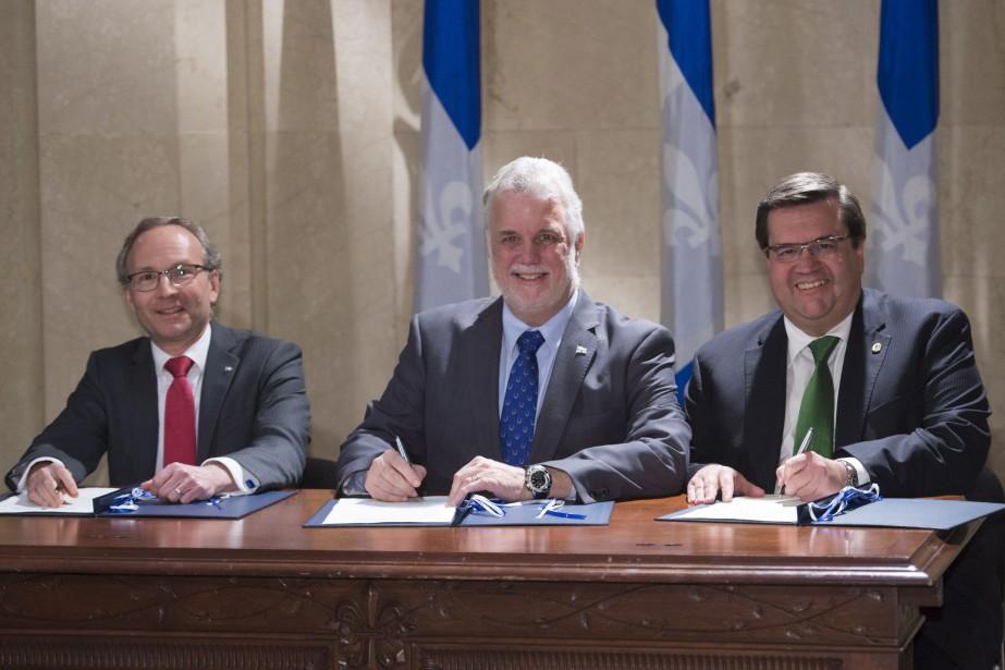 Martin Coiteux, Philippe Couillard et Denis Coderre... (Jacques Boissinot, La Presse canadienne)