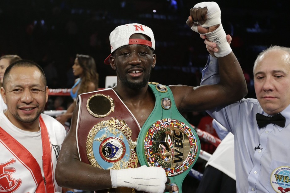 Terence 'Bud' Crawford (au centre)... (Photo Nati Harnik, Associated Press)