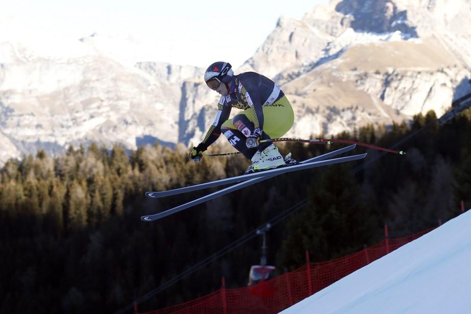 Erik Guay... (Photo Marco Trovati, AP)