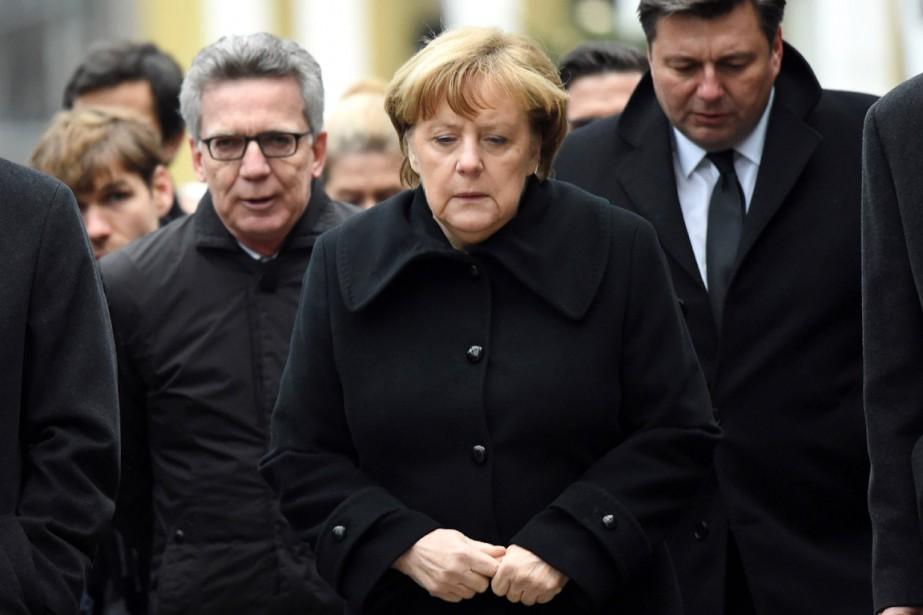 La chancelière allemande et son ministre de l'Intérieur... (photo Maurizio Gambarini, dpa/associated press)