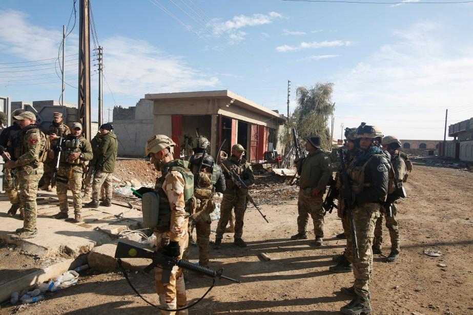 Les forces irakiennes soutenues par la coalition internationale... (REUTERS)