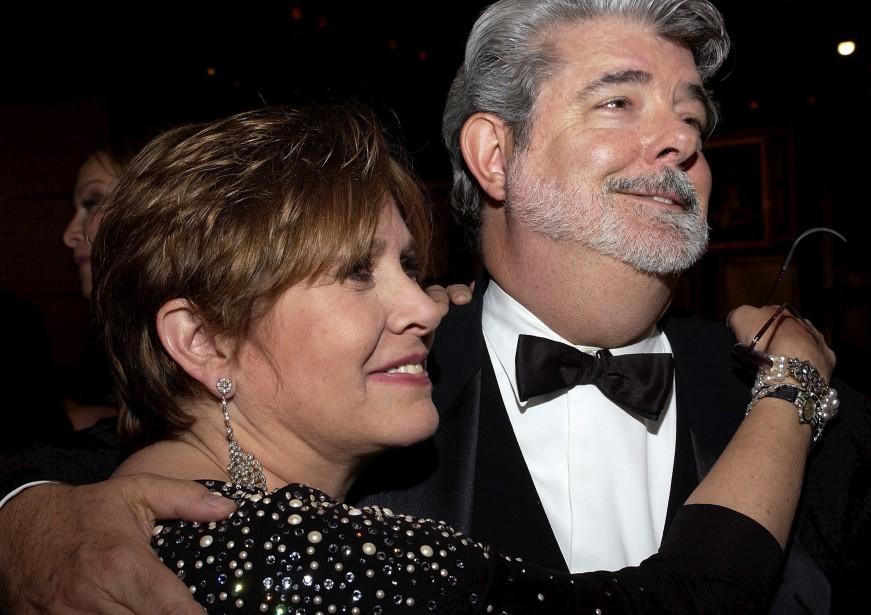 Carrie Fisher et George Lucas lors d'une réception à Los Angeles, en 2005 (AFP)