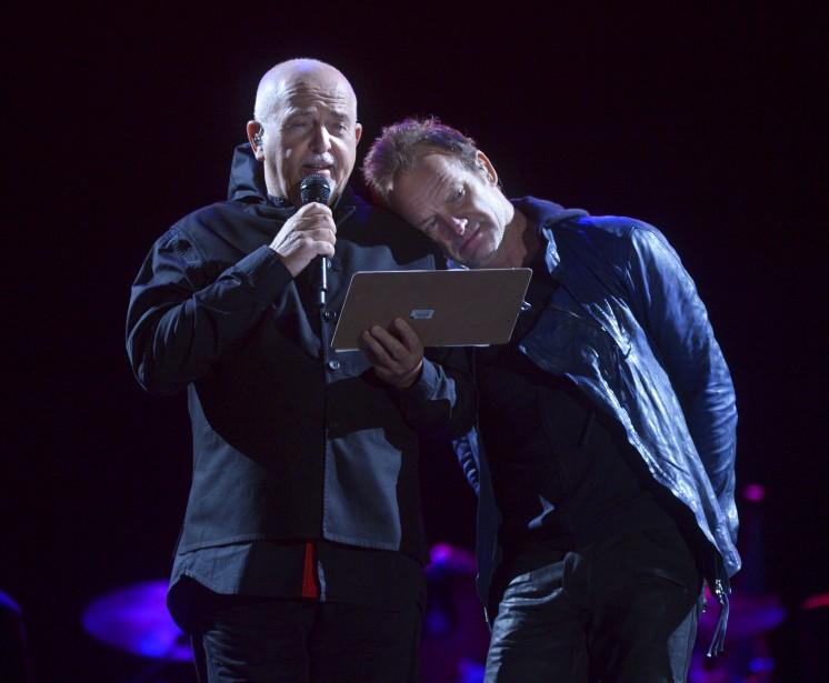 Le 7 juillet, Peter Gabriel et Sting étaient réunis sur les Plaines, pour l'ouverture du 49e Festival d'été. Les deux stars se sont fait un devoir de s'adresser en français à la foule tout au long de ce spectacle de deux heures et demie, qui a permis d'entendre 26 chansons de leur répertoire. «Une ouverture mémorable comme on n'en a pas eu au FEQ depuis longtemps», selon le collègue des arts, Nicolas Houle. (Le Soleil, Jean-Marie Villeneuve)