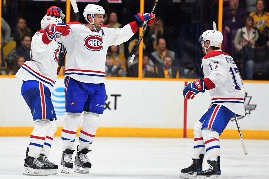 Les joueurs du Canadien fêtant leur victoire contre... (Photo Christopher Hanewinckel, USA Today Sports)