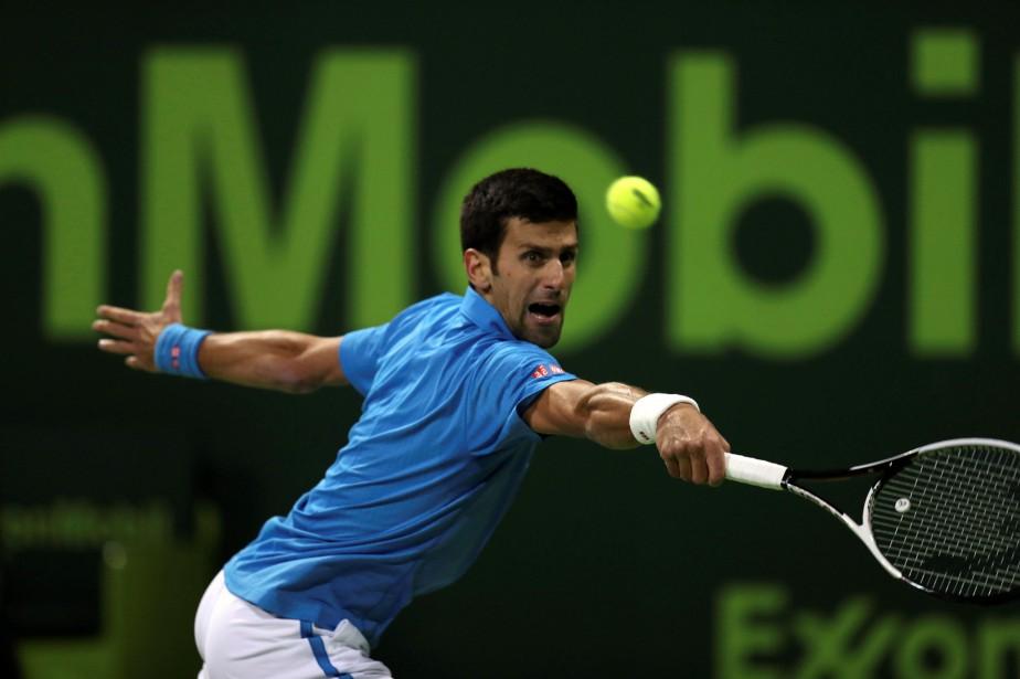 Novak Djokovica dû sauver cinq balles de match... (Photo Ibraheem Al Omari, REUTERS)
