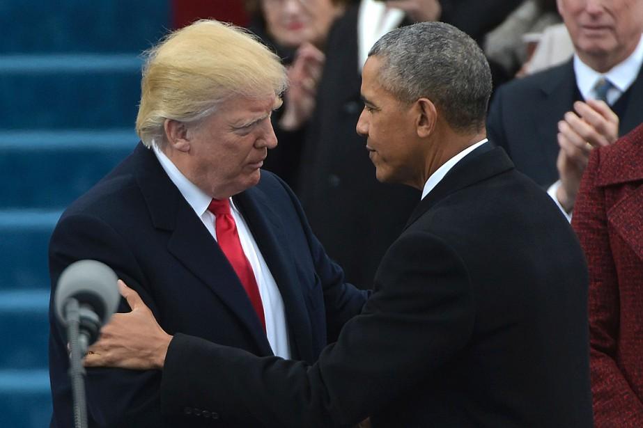 Barack Obama a serré la main de Donald Trump lorsque celui-ci est arrivé sur la plate-forme. (Photo Mandel NGAN, AFP)