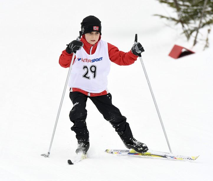 Le jeune Charles-Émile Boily en plein effort, à son arrivée du 2 km dans la classe atome dans le cadre de la course annuelle tenue samedi au Norvégien de Jonquière. (Le Progrès-Dimanche, Rocket Lavoie)