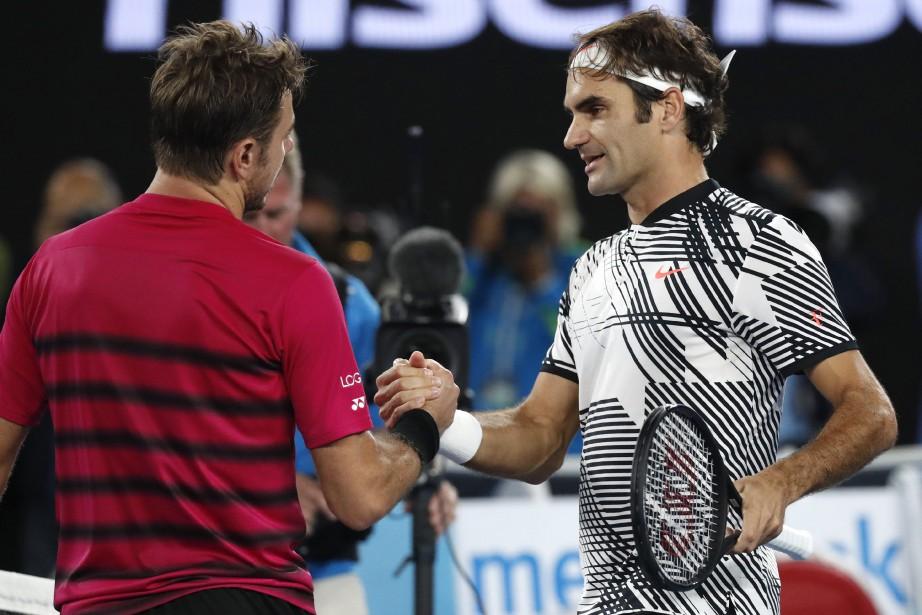 Stanislas Wawrinka etRoger Federer... (Photo Kin Cheung, Associated Press)